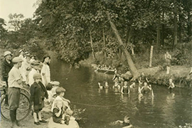 archived photo of Bronx River with swimmers
